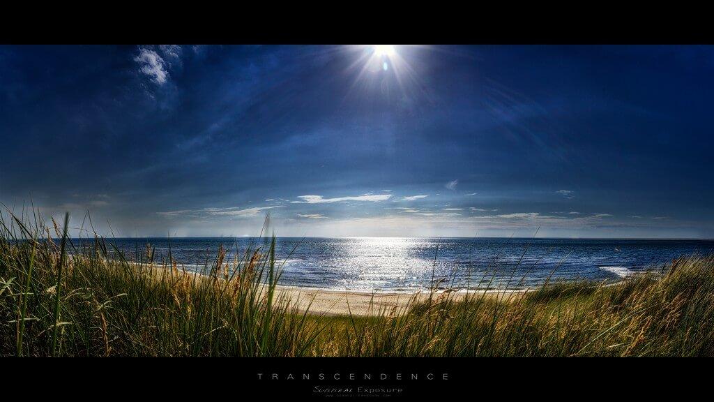 Strand van Den Helder, met zon en blauwe zee