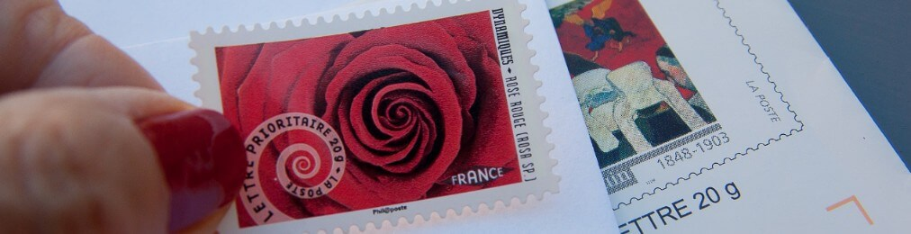 Sending direct mailing tips - pasting a stamp on a letter
