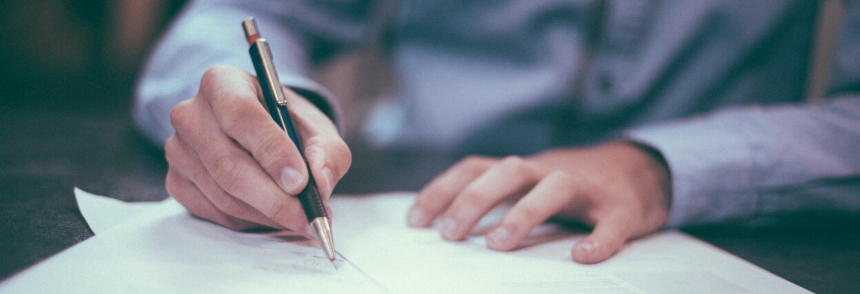 man writes with pen - handwritten personal approach