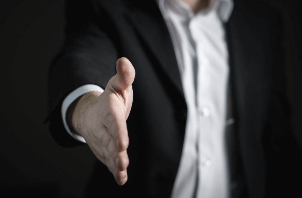 An outstretched hand of a businessman