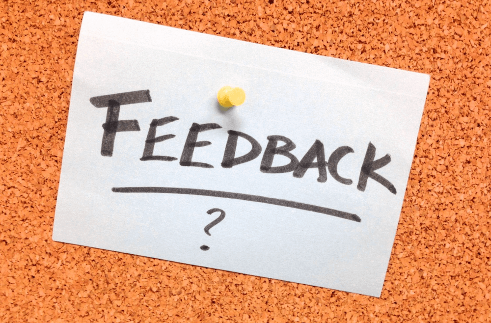 A note with the word 'FEEDBACK' on it, on a wall.