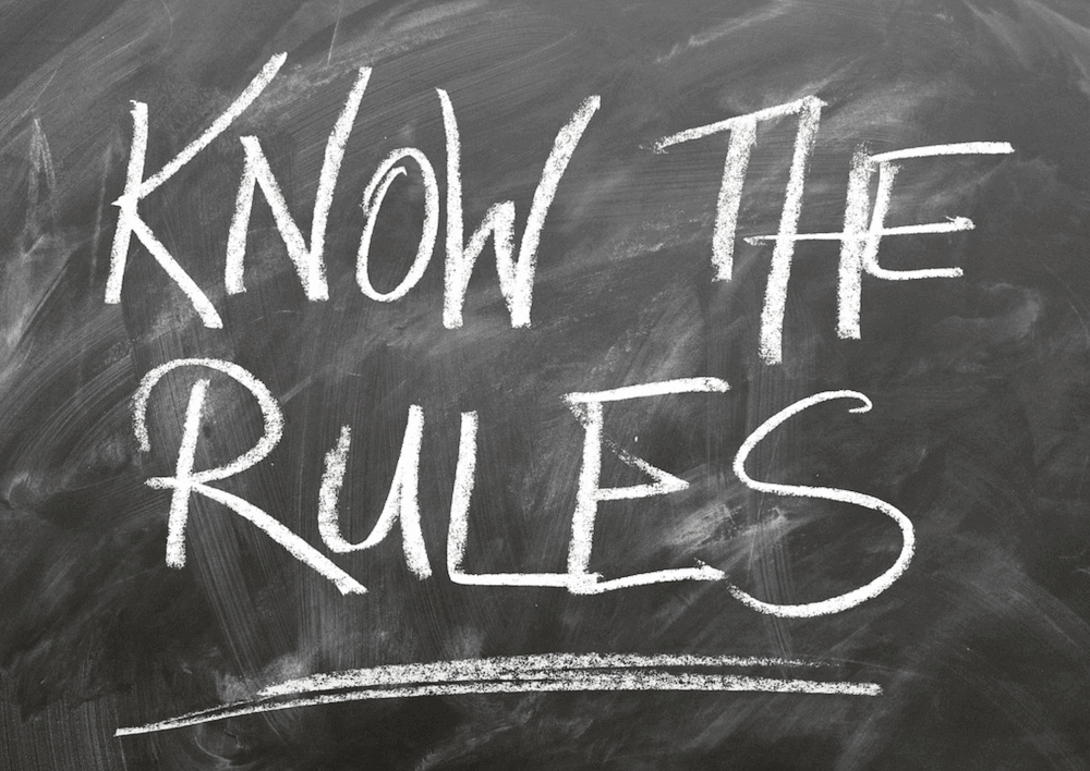 A blackboard that reads: 'KNOW THE RULES' .