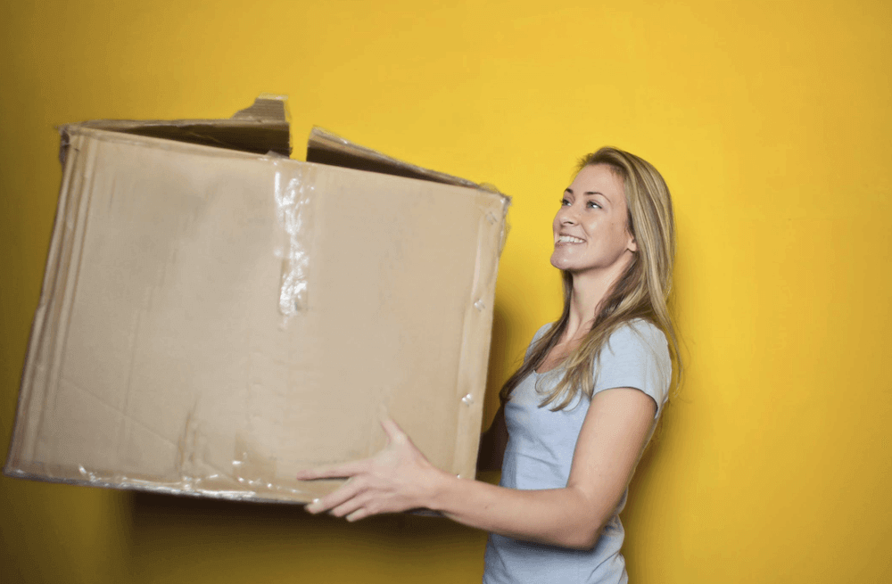 E-commerce Trends - Woman with order box in her hands
