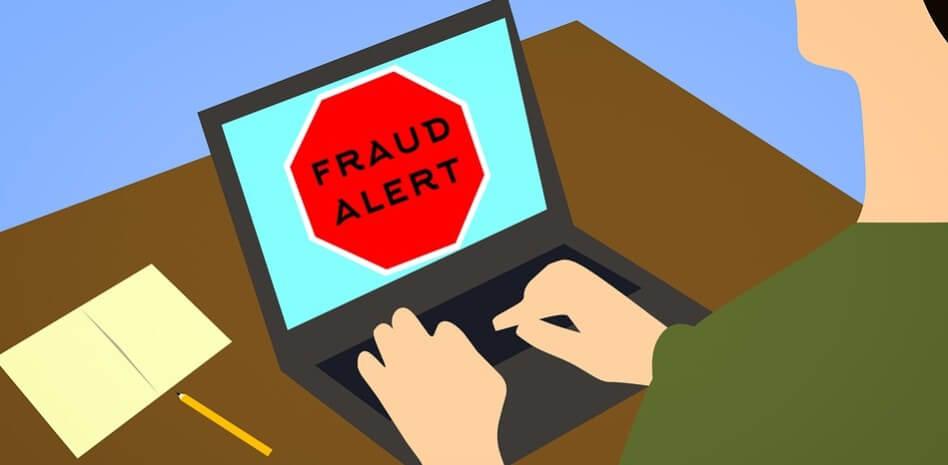 Fraud alert on laptop - cartoon