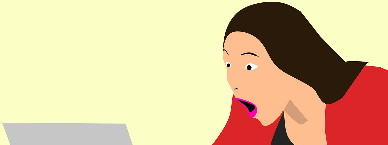 Woman behind laptop gives a strong reaction