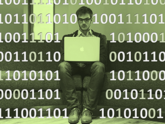 A man with a computer, surrounded by zeros and ones.