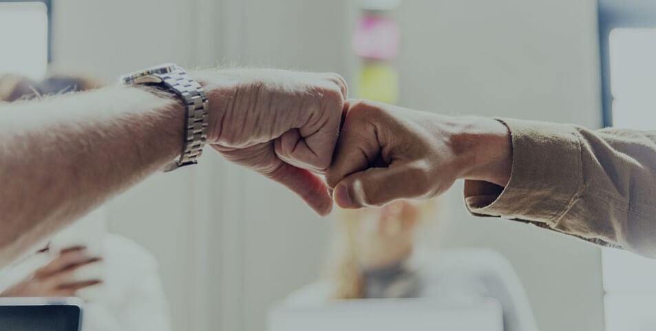 fist bump in front of projectboard - achievement - business