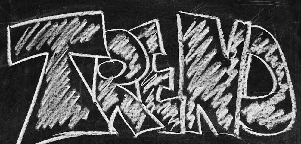 Het woord 'TREND' op een schoolbord.